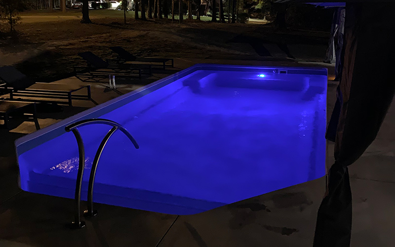 Alaglas Pools Bermuda fiberglass pool in quartz at night