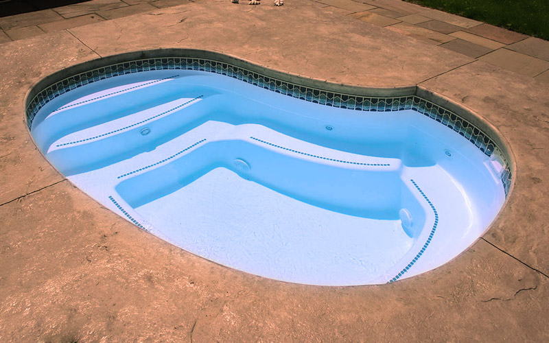 Alaglas Pools' Cove model, small fiberglass pool in white