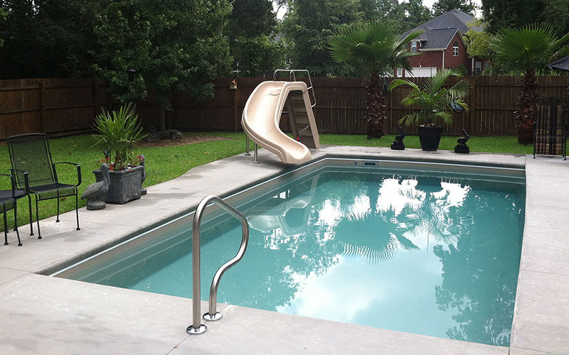 Alaglas Pools' Islander model, medium fiberglass pool in Topaz
