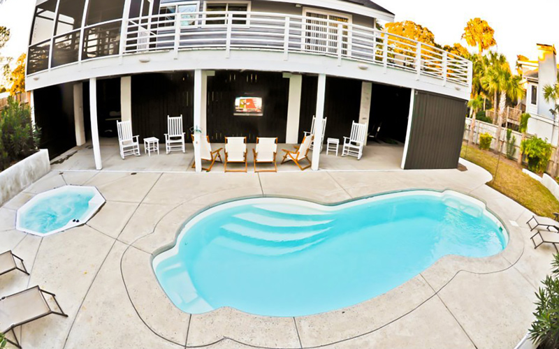 Alaglas Pools' Malibu, a medium, freeform fiberglass pool in white