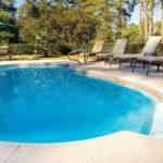Alaglas Pools' Malibu, a medium, freeform fiberglass pool in white