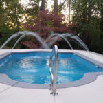 Alaglas Pools' Naples, a medium, rectangular fiberglass pool with fountains in quartz