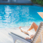 Alaglas Pools woman in Lounge chair by poolounge