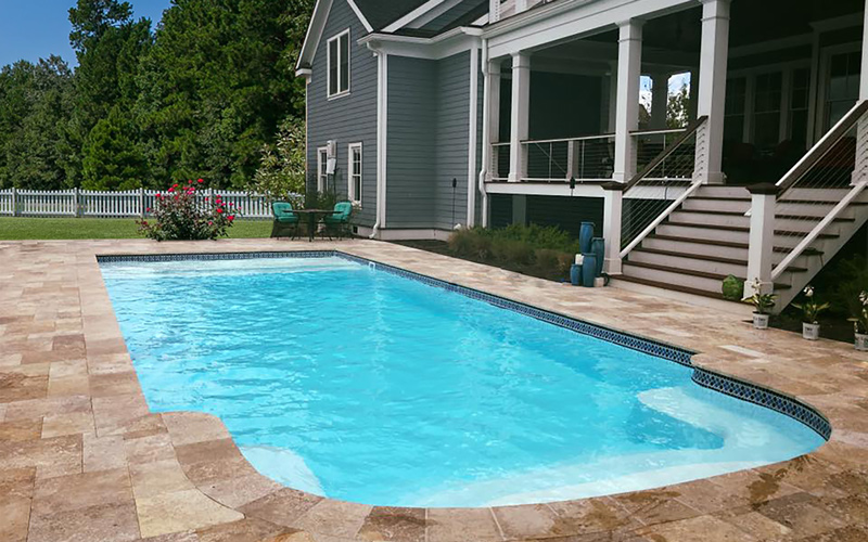 Alaglas Pools' Baron model, a large fiberglass pool in Sapphire blue