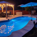 Alaglas Pools' Malibu, a medium, freeform fiberglass pool in quartz