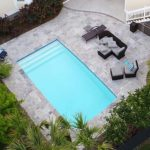 Alaglas Pools' Islander model, a medium-sized fiberglass swimming pool in white