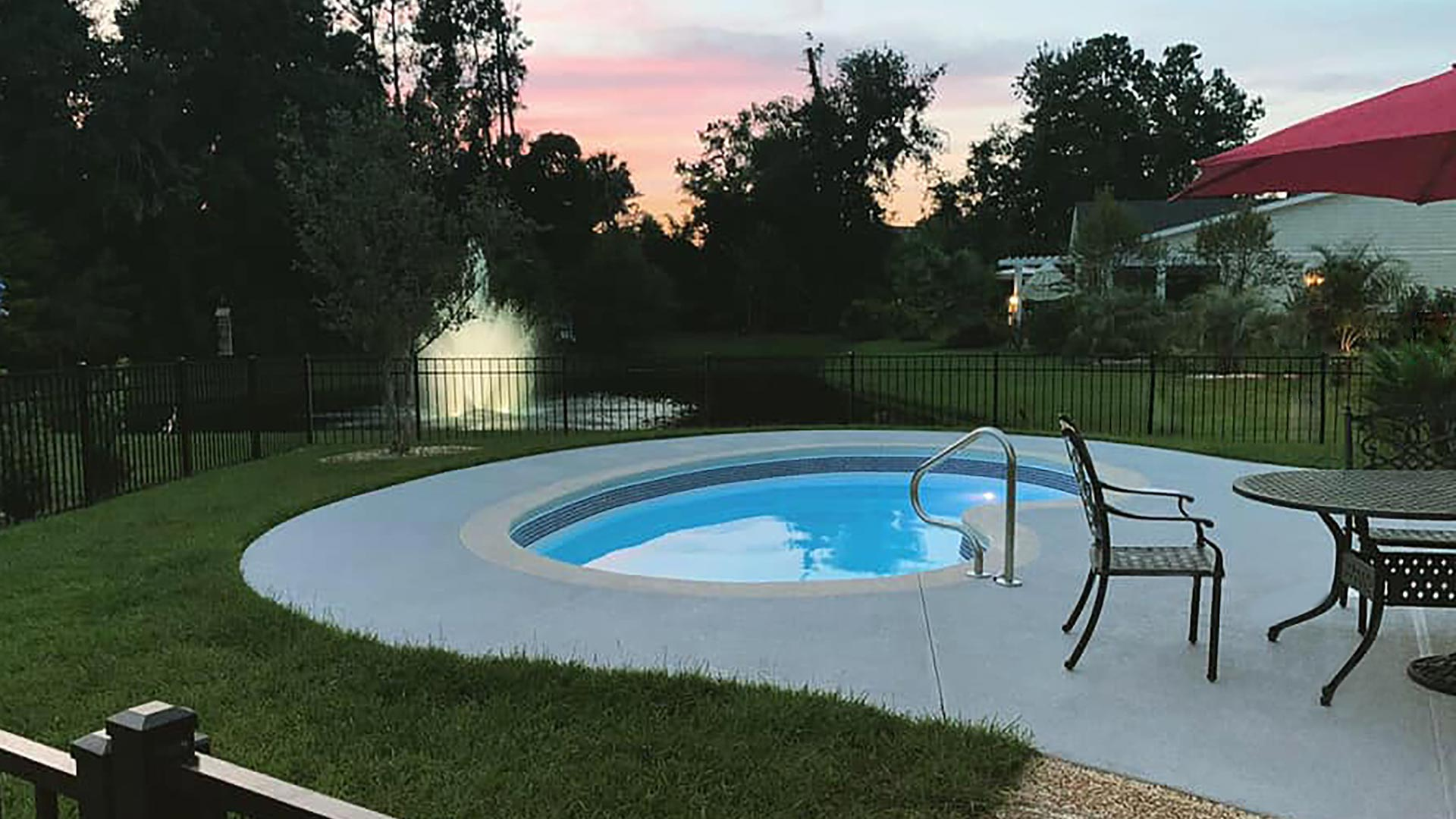 Alaglas Pools' June Bug model, a medium, freeform fiberglass pool in white