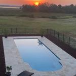 Alaglas Pools' Majestic model, a large, rectangular fiberglass pool in quartz
