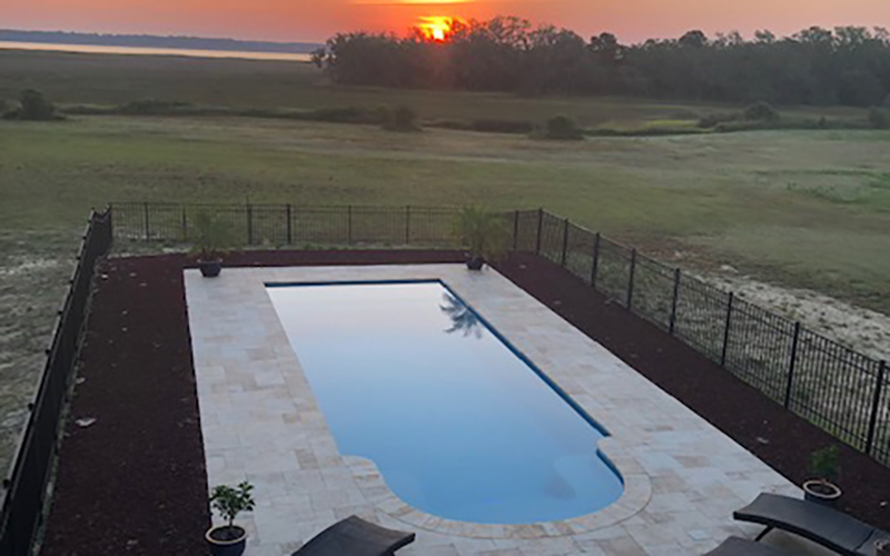 Alaglas Pools' Majestic model, a large, rectangular fiberglass pool in quartz